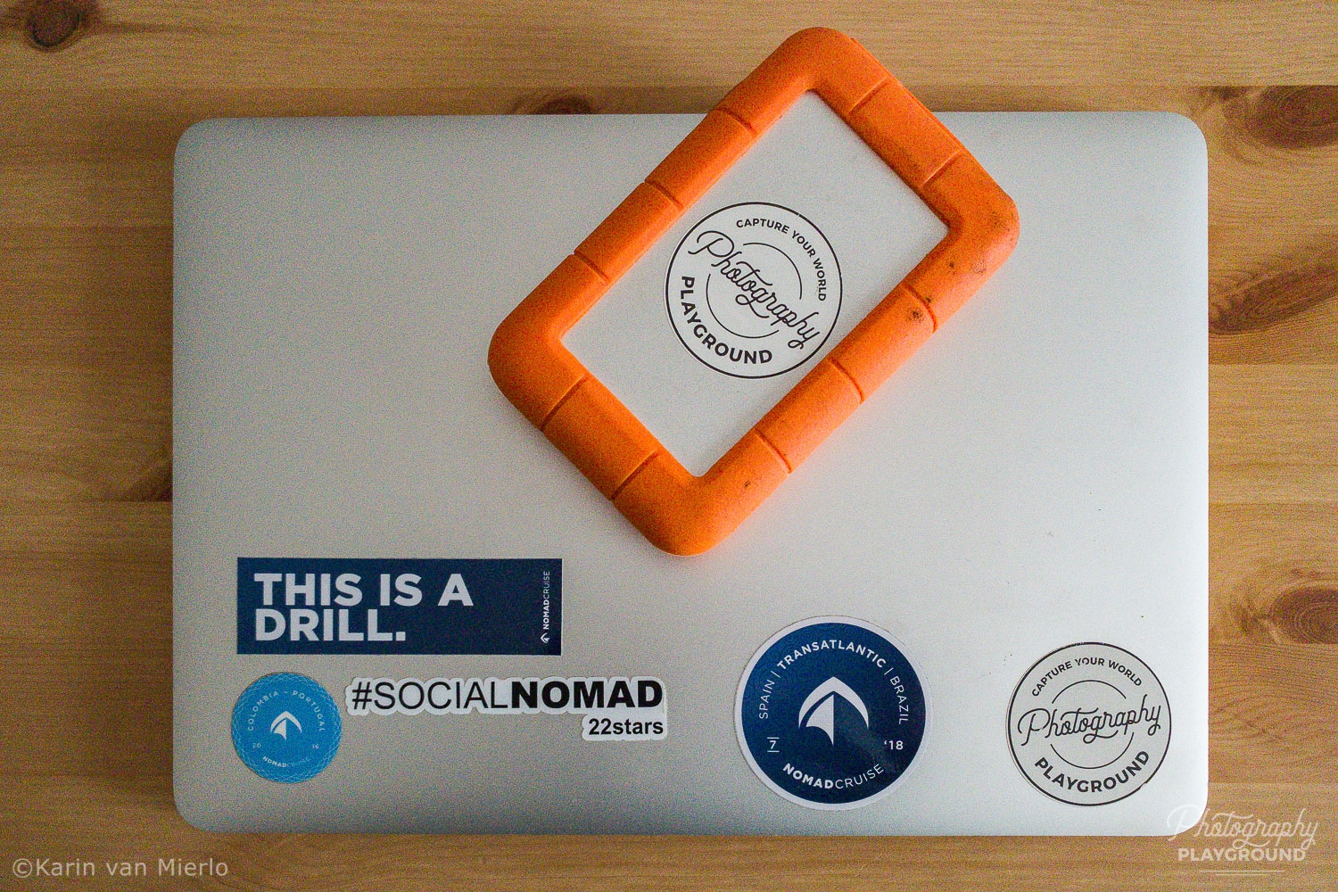 travel photography safety tips, portable photo storage, photo storage device, photo backup device | Photo: Macbook and LaCie Rugged External Storage Unit © Karin van Mierlo, Photography Playground