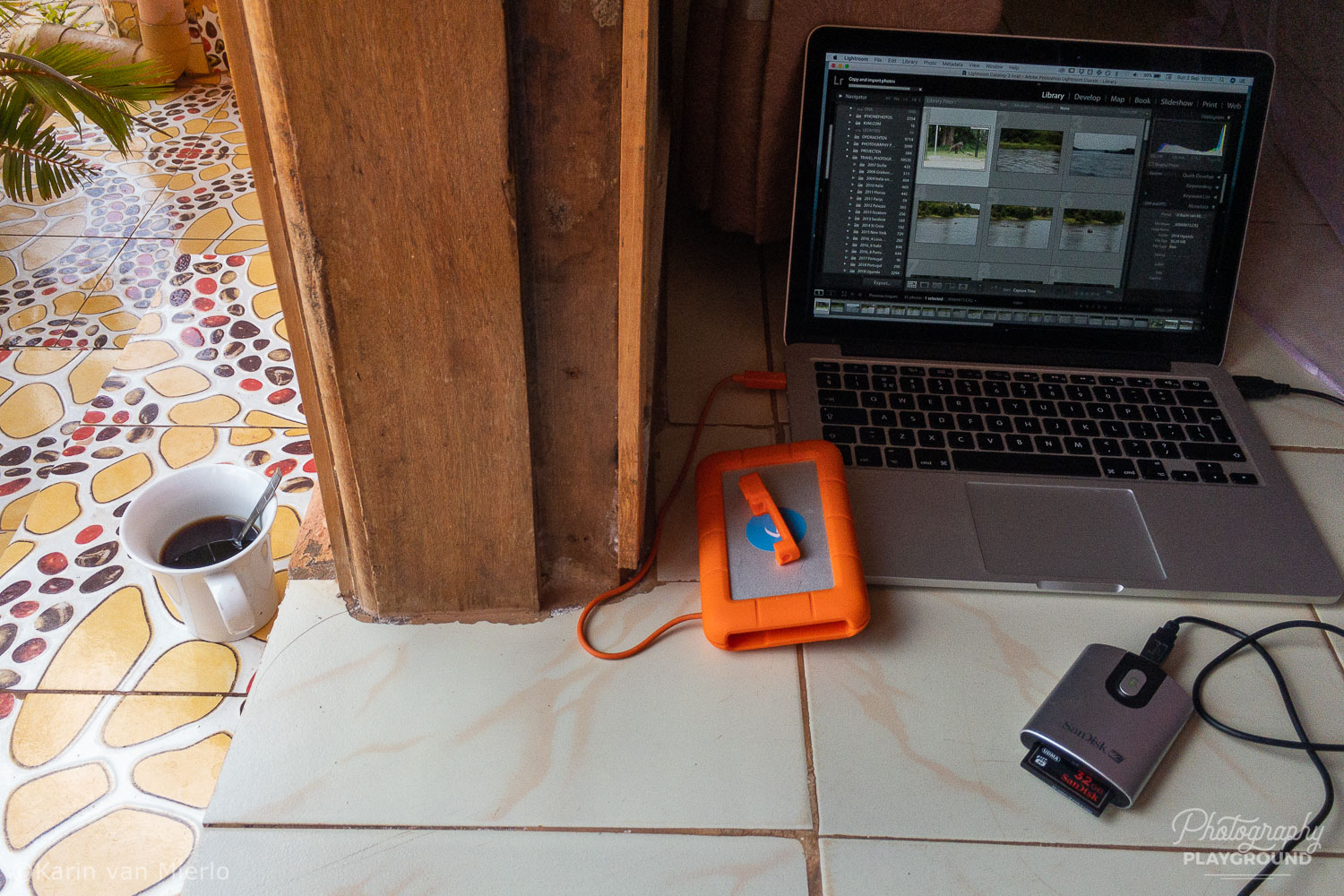 travel photography safety tips, portable photo storage, photo storage device, photo backup device | Photo: Uploading from the card reader to the LaCie Rugged external hard drive © Karin van Mierlo, Photography Playground
