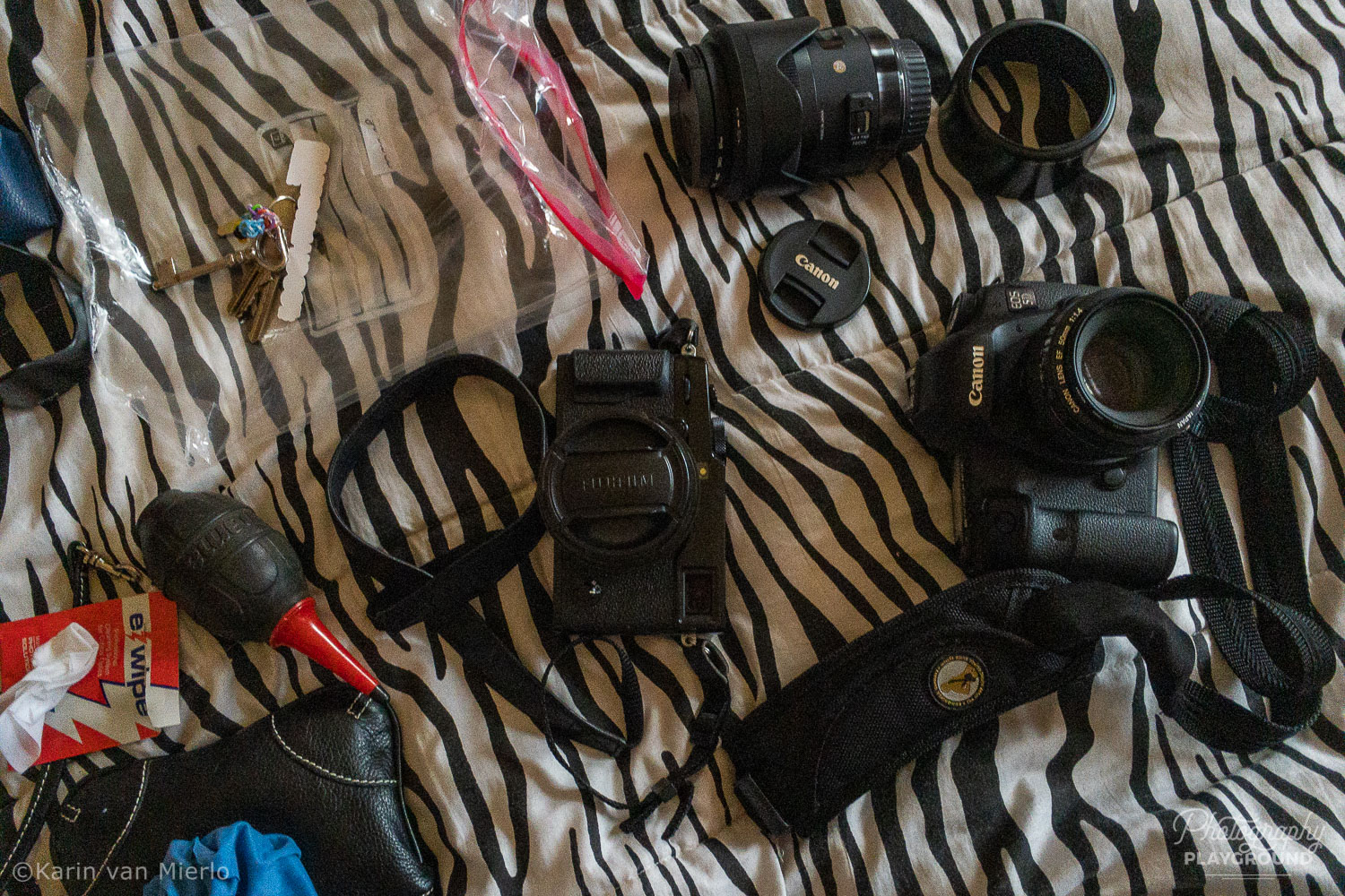 travel photography safety tips | Photo: My cameras on the bed © Karin van Mierlo, Photography Playground