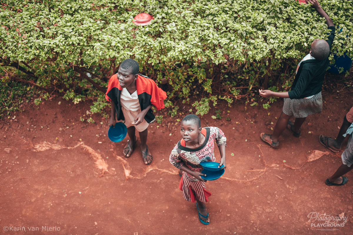 principles of composition in photography, photo composition examples, composition techniques, composition rules, point of view | Copyright Karin van Mierlo for Photography Playground. Photo: Kids playing at a school playground  in Kampala, Uganda.