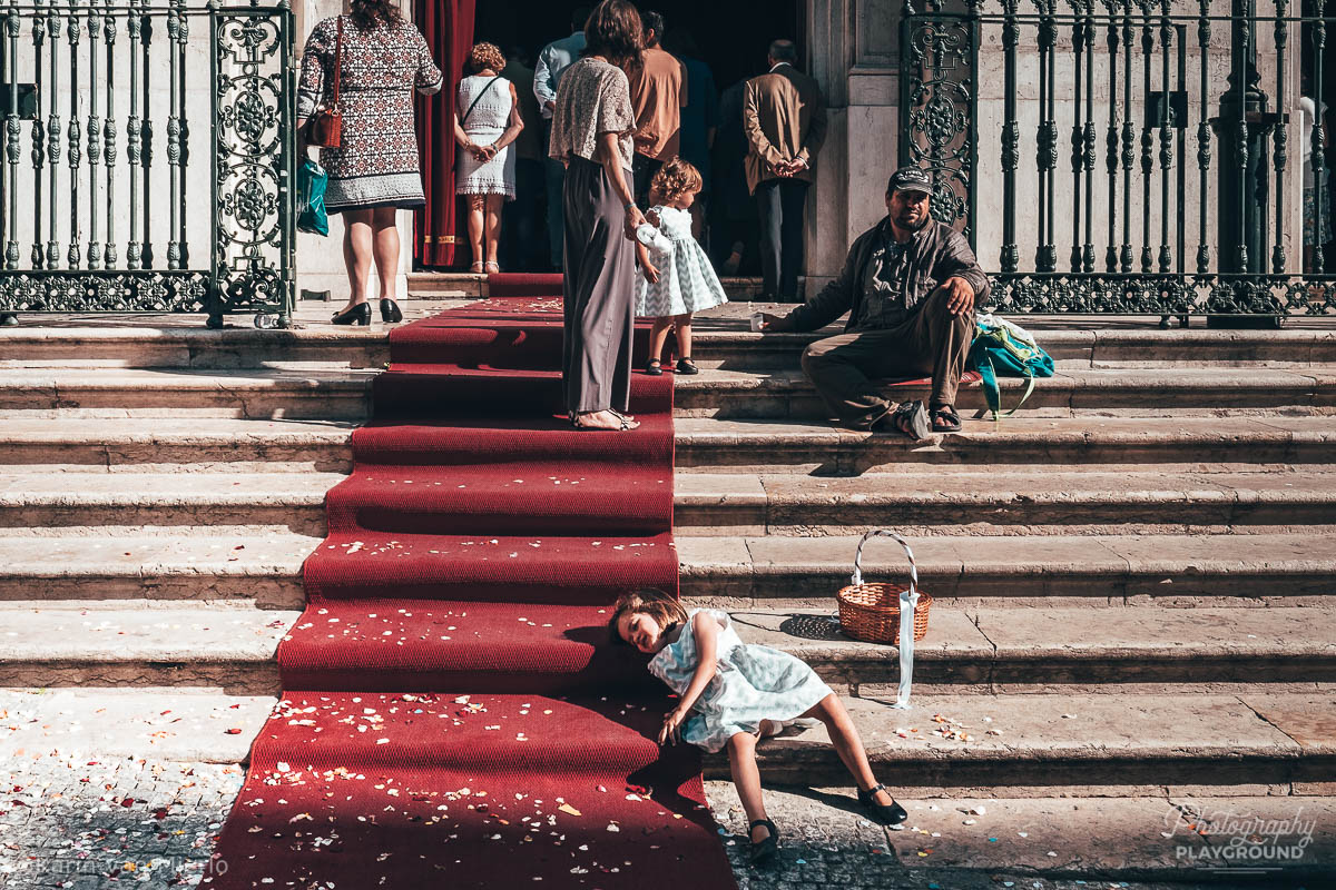 street photography ideas, street photography tips, how to start street photography, street photography cameras | ©Karin van Mierlo Photography Playground Photo: girl on the church stairs during a wedding in Lisbon